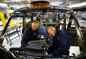 Men work on the production line at the London Taxi Company in Coventry